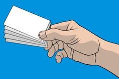 Mano con las tarjetas de visita Foto de archivo libre de regalías