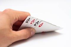 Mano con las tarjetas del póker Imagenes de archivo