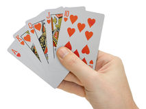 Mano con las tarjetas que juegan Imagen de archivo