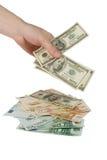 Mano con le fatture del dollaro Fotografie Stock