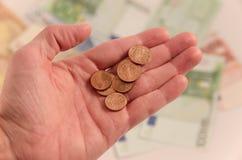 Mano con le monete Fotografia Stock