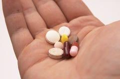 Mano con le pillole Fotografia Stock