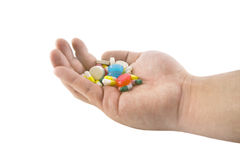 Mano con le pillole ed i ridurre in pani Fotografie Stock Libere da Diritti