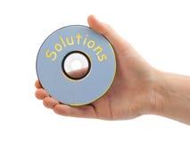 Mano con le soluzioni cd Fotografie Stock