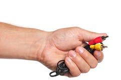 Mano con los conectores de cable Foto de archivo libre de regalías