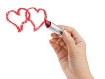 Mano con los corazones del dibujo del lápiz labial Foto de archivo libre de regalías