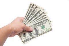 Mano con los dólares Foto de archivo libre de regalías