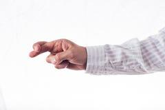 Mano con los dedos cruzados Fotografía de archivo