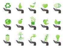 Mano con los iconos verdes del eco Imagen de archivo