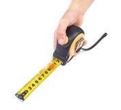 Mano con nastro adesivo di misurazione Immagine Stock