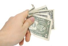 Mano con pocos dólares aislados en blanco Fotografía de archivo