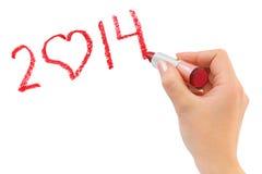 Mano con rossetto che disegna 2014 Fotografie Stock