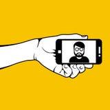 Mano con smartphone y el selfie fotografía de archivo