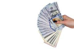 Mano con soldi isolati su priorità bassa bianca Dollari americani a disposizione Manciata di soldi Soldi d'offerta della donna di Immagine Stock