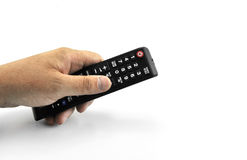 Mano con telecomando che indica in avanti isolata all'11 settembre 2016 bianco Fotografia Stock Libera da Diritti