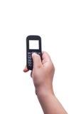Mano con teletphone viejo aislada, trayectoria de recortes Foto de archivo