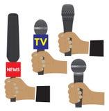 Mano con un micrófono Imagen de archivo