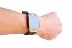Mano con un orologio astuto Fotografia Stock