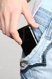 Mano con un telefono mobile Fotografia Stock Libera da Diritti