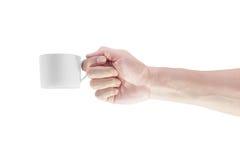 Mano con una taza del café con leche aislada en el fondo blanco Foto de archivo libre de regalías