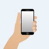 Mano con uno smartphone Fotografie Stock Libere da Diritti