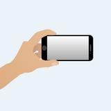 Mano con uno smartphone orizzontalmente Immagini Stock
