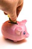 Mano, contanti, la Banca Piggy Immagine Stock
