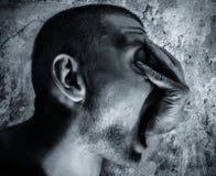 Mano dal ritratto bianco di concetto del nero scuro della bocca, diavolo Fotografia Stock