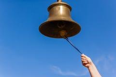 Mano de cobre amarillo de Bell Fotos de archivo
