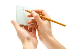 Mano de la muchacha que sostiene el lápiz Imagenes de archivo