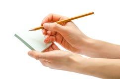 Mano de la muchacha que sostiene el lápiz Foto de archivo libre de regalías