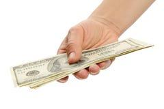 Mano de la mujer con 100 billetes de dólar Fotografía de archivo libre de regalías