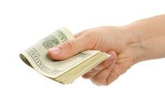 Mano de la mujer con 100 billetes de dólar Fotos de archivo libres de regalías