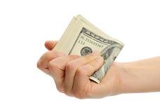 Mano de la mujer con 100 billetes de dólar Imágenes de archivo libres de regalías