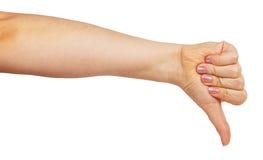 Mano de la mujer con el pulgar abajo Foto de archivo libre de regalías