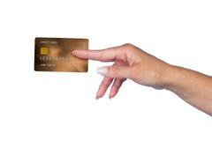 Mano de la mujer con la tarjeta de crédito Imagen de archivo libre de regalías