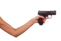 Mano de la mujer con un arma Fotografía de archivo libre de regalías