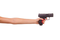 Mano de la mujer con un arma Imagen de archivo libre de regalías