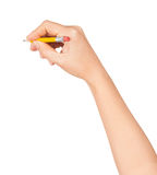 Mano de la mujer con un lápiz corto Imágenes de archivo libres de regalías