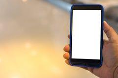 Mano de la persona que sostiene smartphone fotografía de archivo libre de regalías