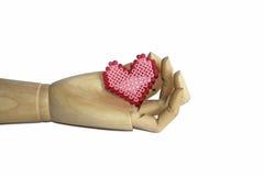 Mano de madera con el corazón Foto de archivo libre de regalías