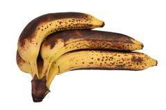 Mano de plátanos demasiado maduros Imágenes de archivo libres de regalías