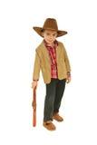 Mano de reclinación del pequeño vaquero en el juguete del arma Imagen de archivo libre de regalías