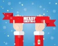 Mano de Santa Claus que lleva a cabo Feliz Navidad de la cinta Imagen de archivo