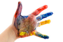 Mano dei bambini nella vernice Fotografia Stock Libera da Diritti