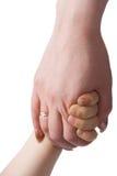 Mano del bambino in braccio della madre Immagini Stock