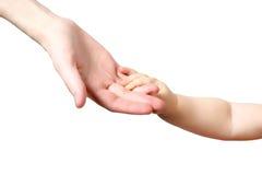 Mano del bambino sulla mano della madre Fotografie Stock Libere da Diritti