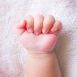 Mano del bebé del puño Fotografía de archivo