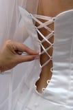 Mano del corsé de la alineada de la novia foto de archivo libre de regalías