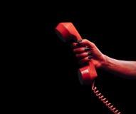 Mano del demone con il microtelefono del telefono immagine stock libera da diritti